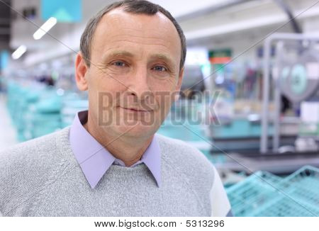 Closeup Elderly Man In Shop With Empty Counters