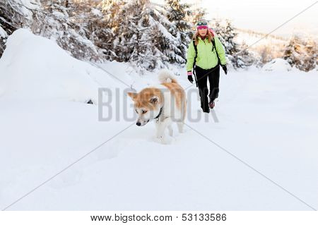 Woman Winter Hiking With Dog