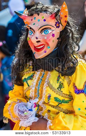 PISAC, PERU - JULY 16: masked woman portrait at Virgen del Carmen parade at Pisac Peru on july 16th, 2013. The Virgin del Carmen festival is in July, includes colorful costumed dancers and a parade.