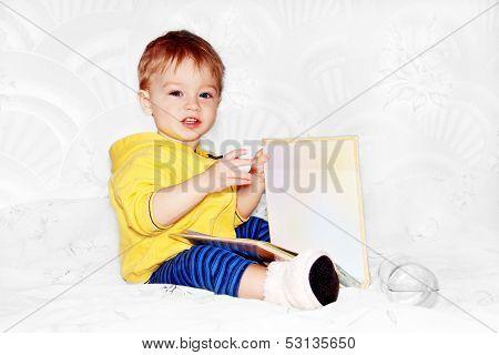 Kid Flips Through A Book.