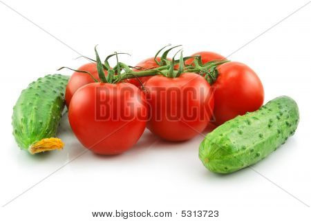 Ripe Tomatoes And Cucumbers Isolated On White