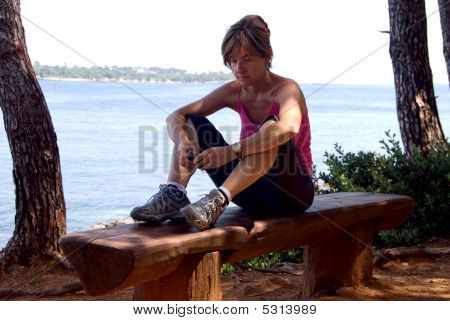 Girl Working  With Phone While On Holiday