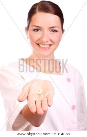 Beautiful Nurse Offering Pills And Smiling