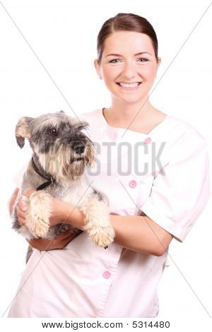Smiling Vet Holding A Cute Dog