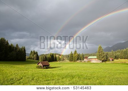 Colorful Rainbow During Rain In Alps