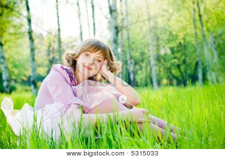 Attractive Girl With Dandelion