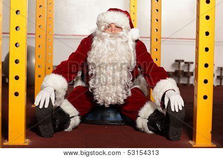Santa Claus in fitness studio portrait