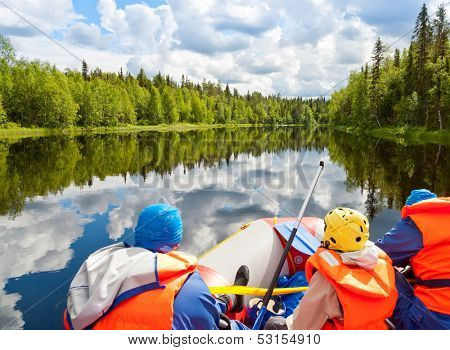 Rafters in a rafting boat on Pistojoki river in Karelia, Russia
