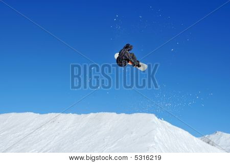 Girl Snowboarder Performing A Jump