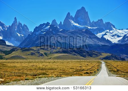 Famous rock Fitz Roy peaks in the Andes. Magnificent panorama of snow-capped mountains in Patagonia. To mountains leads the asphalt road