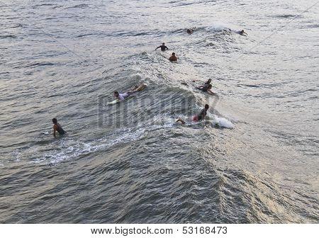 Surfers Wait For Hurricane Sandy
