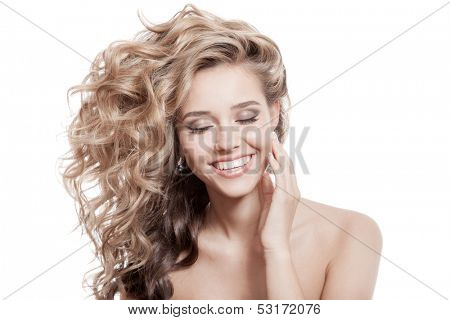 Beautiful Smiling Woman. Healthy Long Curly Hair