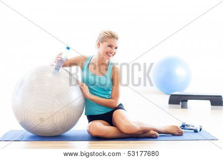 Woman sitting with fitness ball