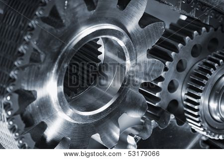 titanium and steel gears powered by a timing chain, blue toning concept