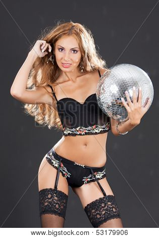 party, entertainment and nightlife concept - woman in black stockings with disco ball
