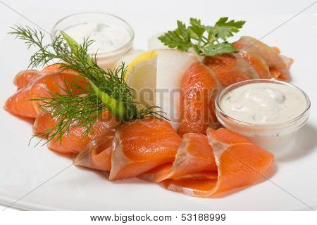 Cold appetizer of smoked halibut, salted trout, sockeye salmon salting cognac with lemon cream mushroom sauce.