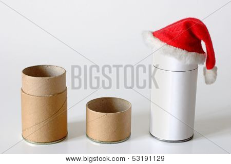 Christmas time for cardboard packages - Cardboard pipe and cap with santa hat.