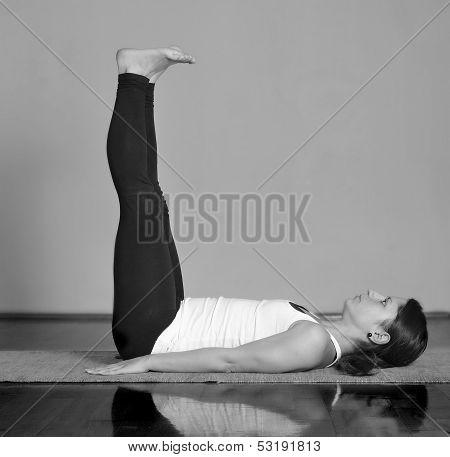 Girl doing Supta Dandasana yoga pose