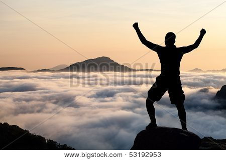 Man Hiking Climbing Silhouette In Mountains