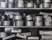 foto of untidiness  - Shelf full of pans all in chrome - JPG