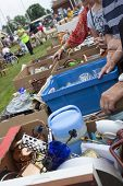 stock photo of junk-yard  - A yard sale held outside with old things laid out on tables