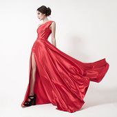 pic of flutter  - Young beauty woman in fluttering red dress - JPG