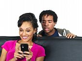 picture of sneaky  - jealous lover snooping on cell phone text conversations - JPG