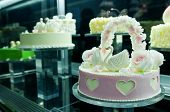 image of tuck-shop  - small wedding cake with few swans figures - JPG