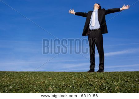 Business Man Arms Outstretched