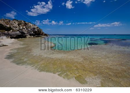 Turquoise Waters By A Deserted Beach