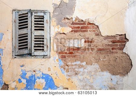 Grunge Damaged Brick Wall With Closed Window. Background Texture