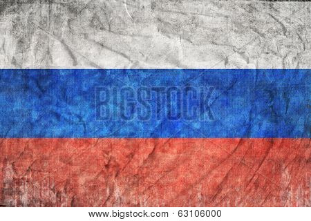 The flag of Russia on a grunge postcard as abstract background.Digitall y generated image.