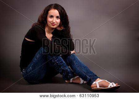Brunette On A Gray Background