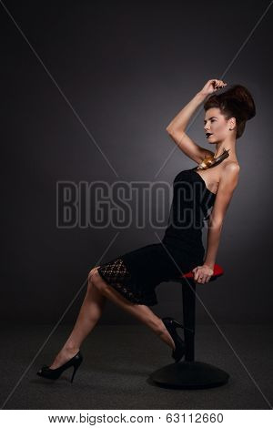 Woman With Snail In Black Dress. Fashion. Gothic