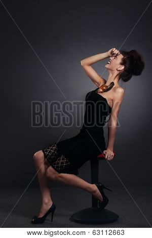Woman With Snail In Black Dress Laughing. Fashion. Gothic