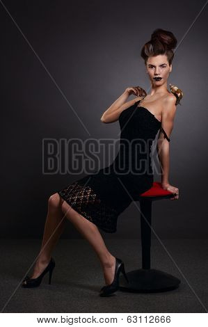 Portrait Of A Woman With Snail In Black Dress. Fashion. Gothic