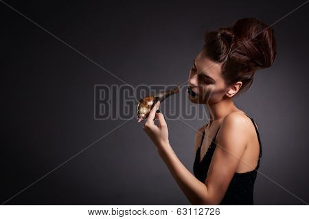 Portrait Of Sexy Woman With Snail In Black Dress. Fashion. Gothic
