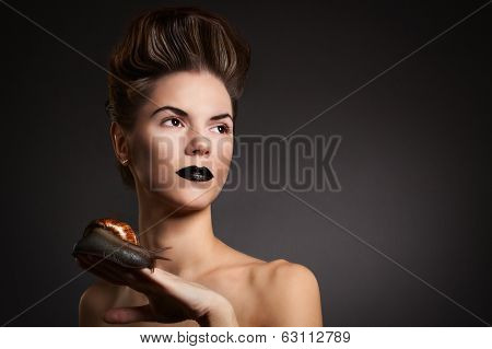 Sexy Woman With Snail With Black Eyes And Lips. Fashion. Gothic