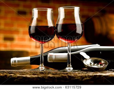 Glasses of red wine in wine cellar