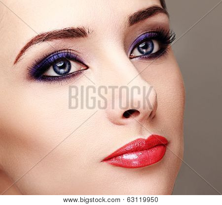 Beautiful Woman With Bright Eyes Makeup And Long Lashes. Closeup