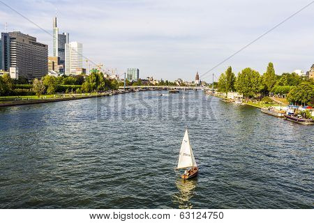 View To River Main With Boat And Skyline Of Frankfurt
