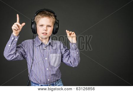 Boy in headphones. Music.