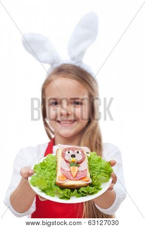 Bunny shaped sandwich presented by little girl with apron and rabbit ears - isolated