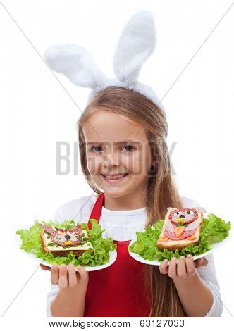 Little bunny ears chef with rabbit themed sandwiches - isolated