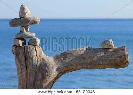 Stone man on dead tree