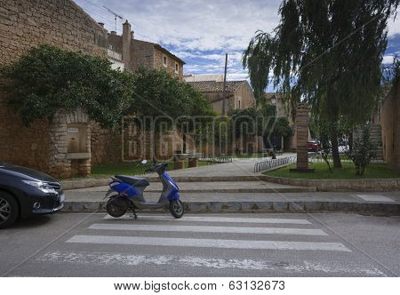 Blue Scooter On Pedestrian Crossing