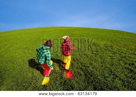 Young Couple In Sportwear Snowboarding On The Grass In The Greenfield
