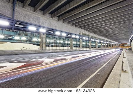 Abstract speed motion in urban highway road tunnel, blurred motion toward the central in hong kong