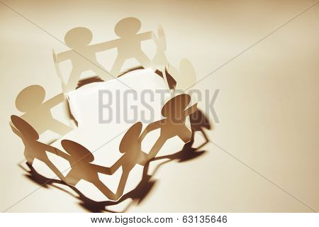 Paper chain people holding hands