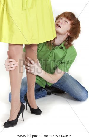 Crying Man Holding Woman Legs